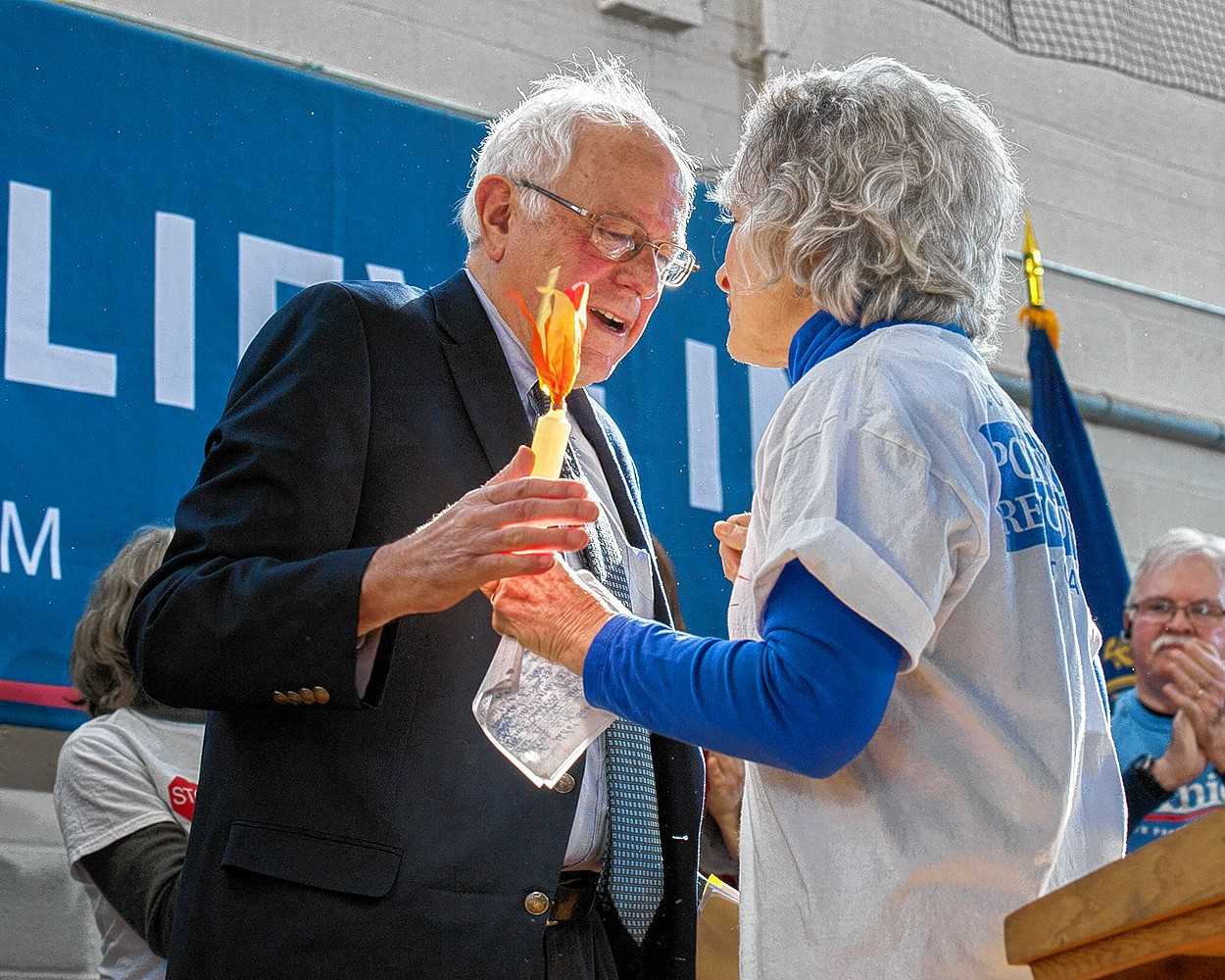 Senator Bernie Sanders visited with the citizens of the Peterborough, NH area this morning. A crowd of some 500 people listened enthusiastically to his campaign talk of income inequality, climate change, the Citizens United decision and high medical costs. Bernie received a symbolic Grannie D torch recognizing his fight to rid elections of big money interests.